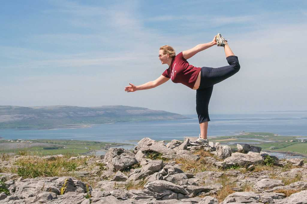 Yoga pose on Abbey hill Burren yoga